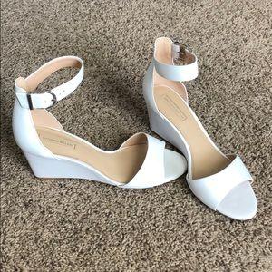 Antonio Melani white ankle strap low wedges